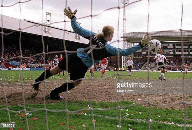 Emma Byrne of Arsenal saves a penalty from Margunn Haugenes of Fulham during the AXA FA Women's Cup Final between Arsenal and Fulham played at...