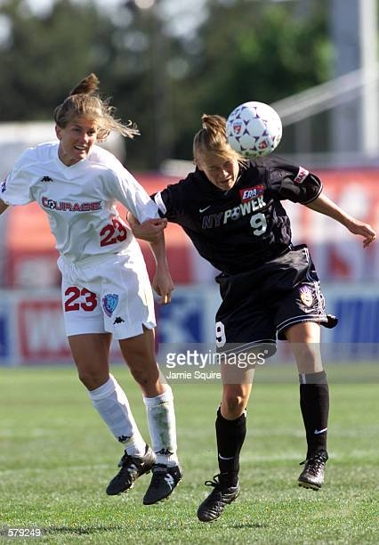 Erin Baxter of the Carolina Courage battles Anne Nielson of the New York Power during the WUSA game at Mitchell Athletic Complex in Uniondale New...
