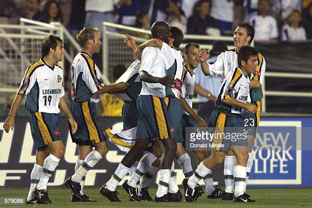 Ezra Hendrickson of the Los Angeles Galaxy and teammates celebrate the goal against the New England Revolution at the Rose Bowl in Pasadena,...