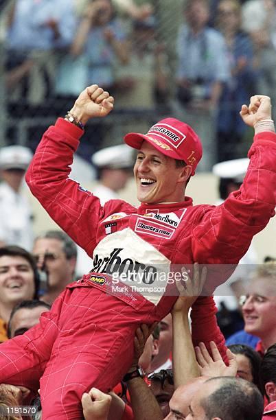 Ferrari driver Michael Schumacher celebrates winning the Formula One Monaco Grand Prix in Monte Carlo, Monaco. \ Mandatory Credit: Mark Thompson...