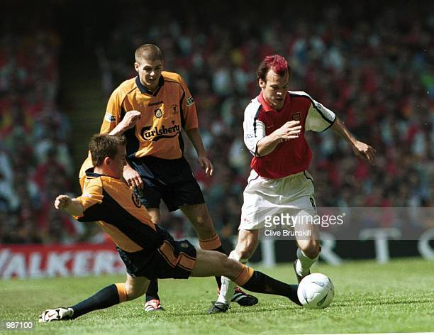 Fredrik Ljungberg of Arsenal is challenged by Vladimir Smicer of Liverpool during the AXA sponsored 2001 FA Cup Final between Arsenal v Liverpool at...