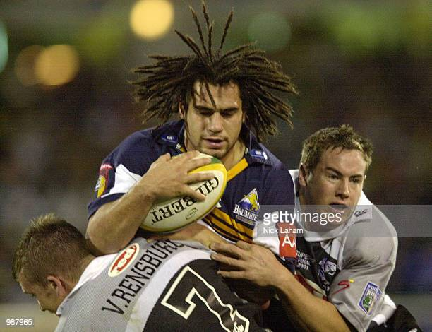 George Smith of the Brumbies is wrapped up by the Sharks defence during the Super 12 Grand Final between the ACT Brumbies and the Sharks at Bruce...