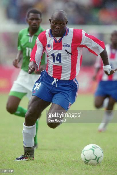 George Weah of Liberia runs with the ball during the World Cup 2002 Group B Second Round Qualifying match against Nigeria played at Port Harcourt in...