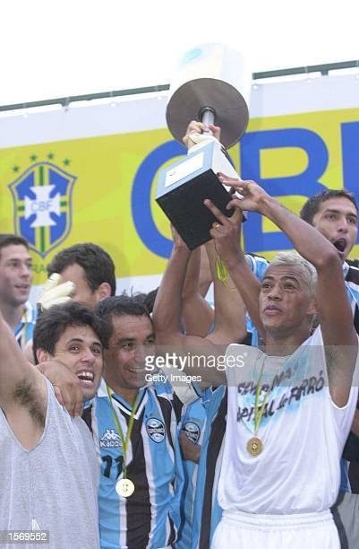 Gremio players celebrate with the trophy after beating Corinthians 31 in the final game of the Copa do Brazil at Morumbi Stadium Sao Paulo Brazil...