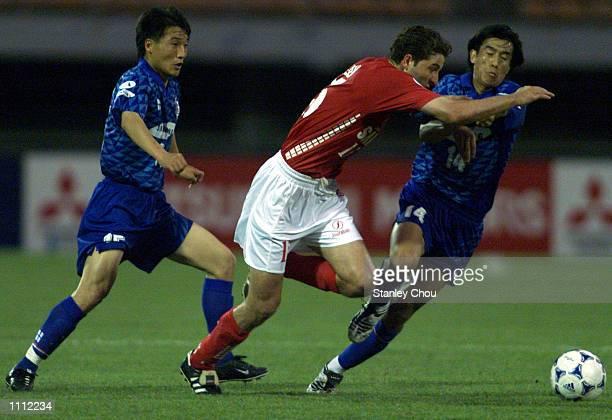 Halali Esmaeil of Pirouzi is challenged by Shin Hong Gi and Seo Jung Won of Suwon Samsung during the Asian Club Football Championship semifinal at...