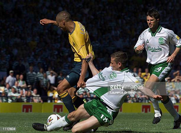 Henrik Larsson of Celtic is tactled by Gary Smith of Hibernian during the Tennent's Scottish Cup Final between Celtic and Hibernian at Hampden Park...