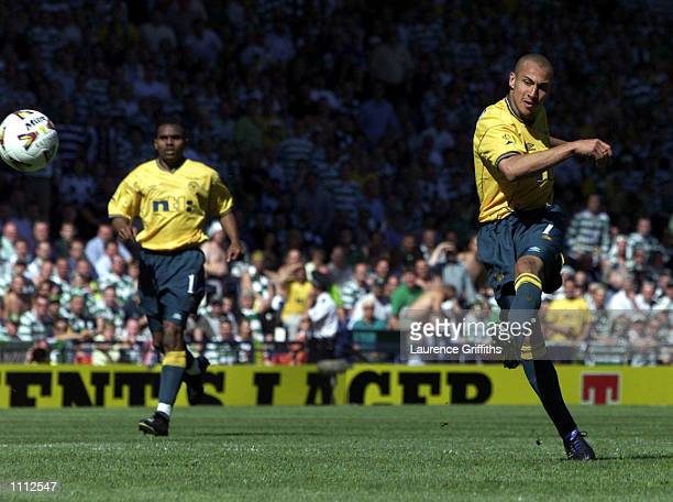 Henrik Larsson of Celtic scores the second goal during the Tennents Scottish FA Cup Final between Celtic v Hibernian at Hampden Park Glasgow DIGITAL...