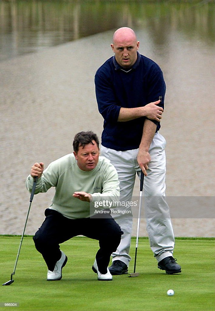 Ian Woosnam of Wales helps Irish rugby player Keith Wood with a putt during the Pro-Am eventat the Benson & Hedges International Open held at the Belfry, Birmingham. Mandatory Credit: Andrew Redington/ALLSPORT