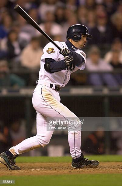 Ichiro Suzuki of the Seattle Mariners drives a ball into the right field corner for a double in the eighth inning against the Baltimore Orioles at...