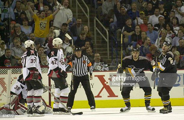 Jaromir Jagr of the Pittsburgh Penguins celebrates his first period power play goal with teammate Kevin Stevens as they took a 10 lead on the Buffalo...