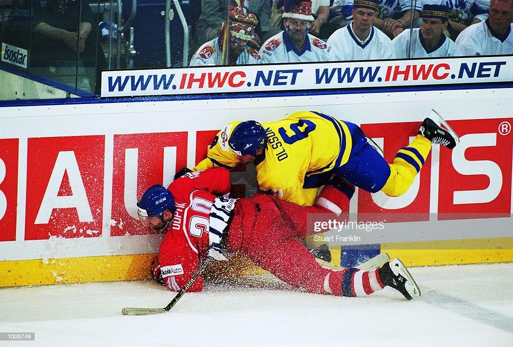 Jiri Dopita of Czechoslavakia and Christer Olsson of Sweden take a tumble during the IIHF World Ice Hockey Championship Semi-final match between Czechoslavakia and Sweden held at the Preussag Arena in Hanover, Germany. \ Mandatory Credit: Stuart Franklin /Allsport