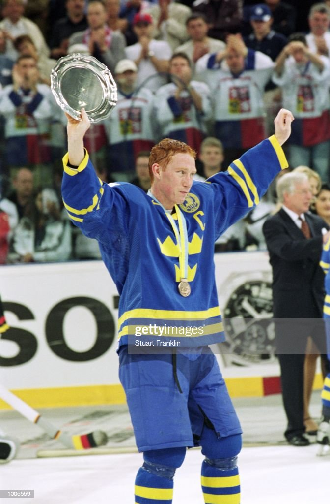 Jorgen Jonsson of Sweden celebrates with the shield after the IIHF World Ice Hockey Championship Third place play-off match between Sweden and the USA played at the Preussag Arena in Hannover, Germany. \ Mandatory Credit: Stuart Franklin /Allsport