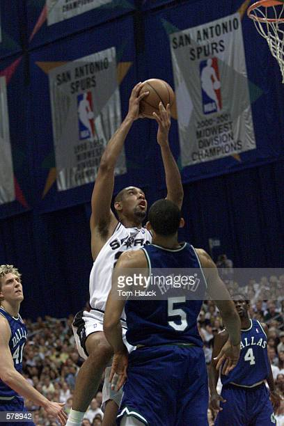 Juwan Howard of the Dallas Mavericks watches Tim Duncan of the San Antonio Spurs drive to the hoop during game 1 of the NBA West Semifinals at the...