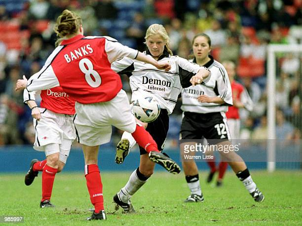 Katie Chapman of Fulham is challenged by Angela Banks of Arsenal during the AXA FA Women's Cup Final between Arsenal and Fulham played at Selhurst...