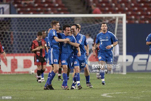 Kerry Zavagnin of the Kansas City Wizards is congratulated by teammates following a goal against the New York/New Jersey MetroStarsas at Giants...