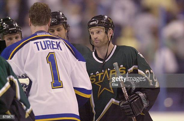 Kirk Muller of the Dallas Stars congratulates goalie roman Turek of the St Louis Blues after Game 4 of the Western Conference Semifinals at the...