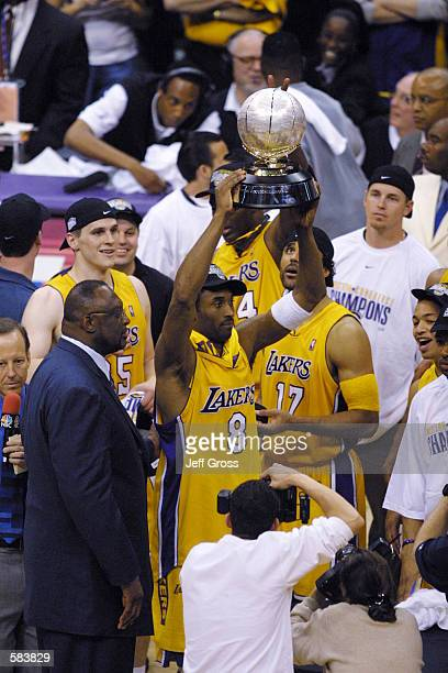 Kobe Bryant of the Los Angeles Lakers holds up the western conference championship trophy after defeating the San Antonio Spurs at Staples Center in...