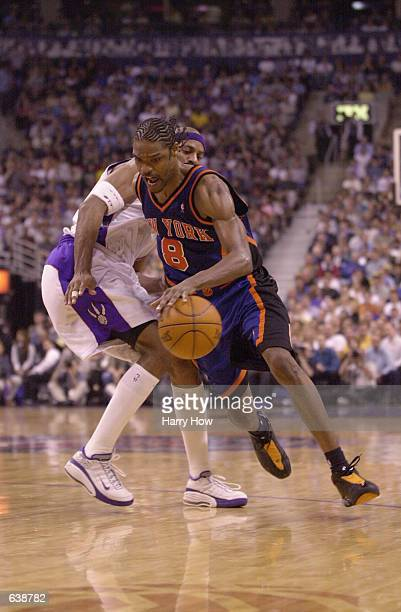 Latrell Sprewell of the New York Knicks drives past Jerome Williams of the Toronto Raptors in game four of round one of the NBA playoffs at the Air...