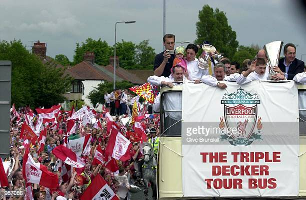 Liverpool celebrate with the trophys during the Liverpool Football Club open top bus city tour with winning trophys Mandatory Credit Clive...
