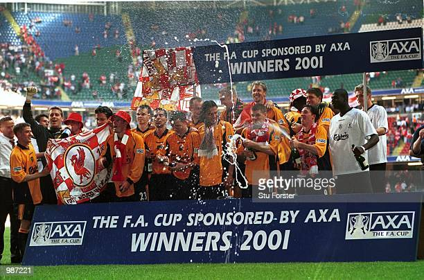 Liverpool players celebrate after winning the AXA sponsored 2001 FA Cup Final between Arsenal v Liverpool at the Millennium Stadium Cardiff Mandatory...