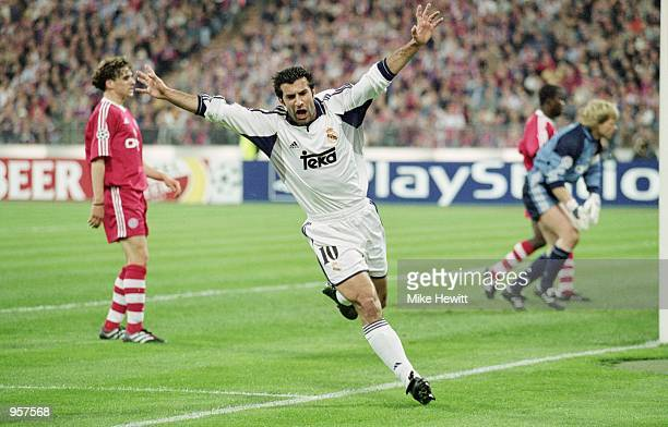 Luis Figo of Real Madrid celebrates scoring a goal during the UEFA Champions League Semifinal Second Leg between Bayern Munich and Real Madrid at the...