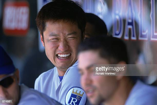 Mac Suzuki of the Kansas City Royals enjoys a good laugh in the dugout during the game against the Texas Rangers at the Ballpark in Arlington Texas...