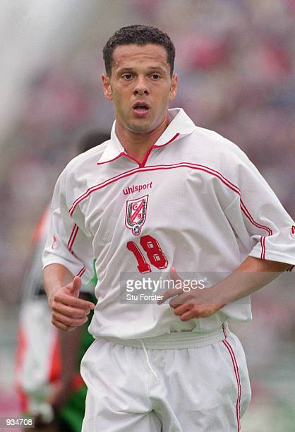 Maher Kanzari of Tunisia in action during the World Cup 2002 Group D Qualifying match against Ivory Coast played at the El Menzah Stadium in Tunis...
