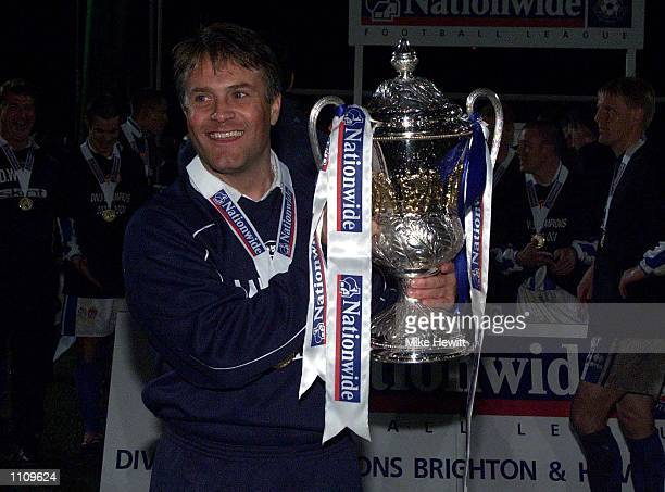Manager Micky Adams of Brighton lifts the third division title after the match between Brighton and Hove Albion and Chesterfield in the Nationwide...