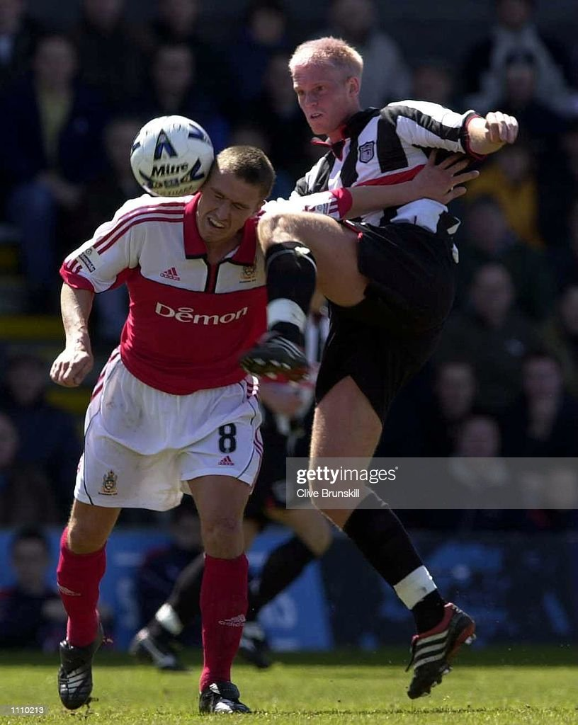 Menno Willems of Grimsby Town tackles Lee Clark of Fulham during the Nationwide First Division match between Grimsby Town and Fulham at Blundell Park, Cleethorpes. Digital Image Mandatory Credit: Clive Brunskill/ALLSPORT