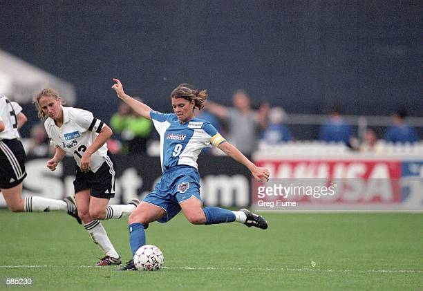Mia Hamm of the Washington Freedom kicks the ball during the WUSA game against the Boston Breakers at the RFK Stadium in Washington D C The Breakers...