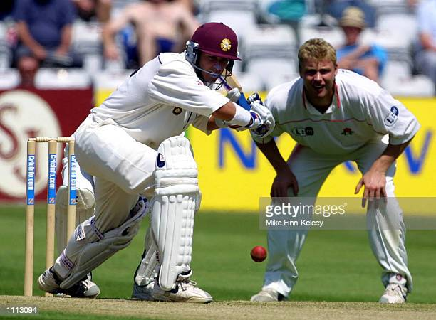 Michael Hussey of Northamptonshire hits out on his way to 70 on day one of the CricInfo County Championship match against Lancashire at Wantage Road...
