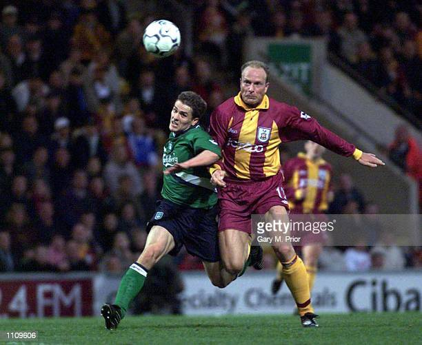 Michael Owen of Liverpool clashes with Robert Molenaar of Bradford during the Bradford City v Liverpool FA Carling Premiership Match at Valley...