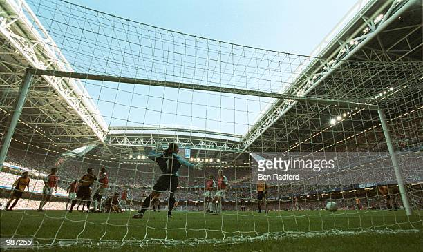 Michael Owen of Liverpool score the first goal during the AXA sponsored 2001 FA Cup Final between Arsenal v Liverpool at the Millennium Stadium...