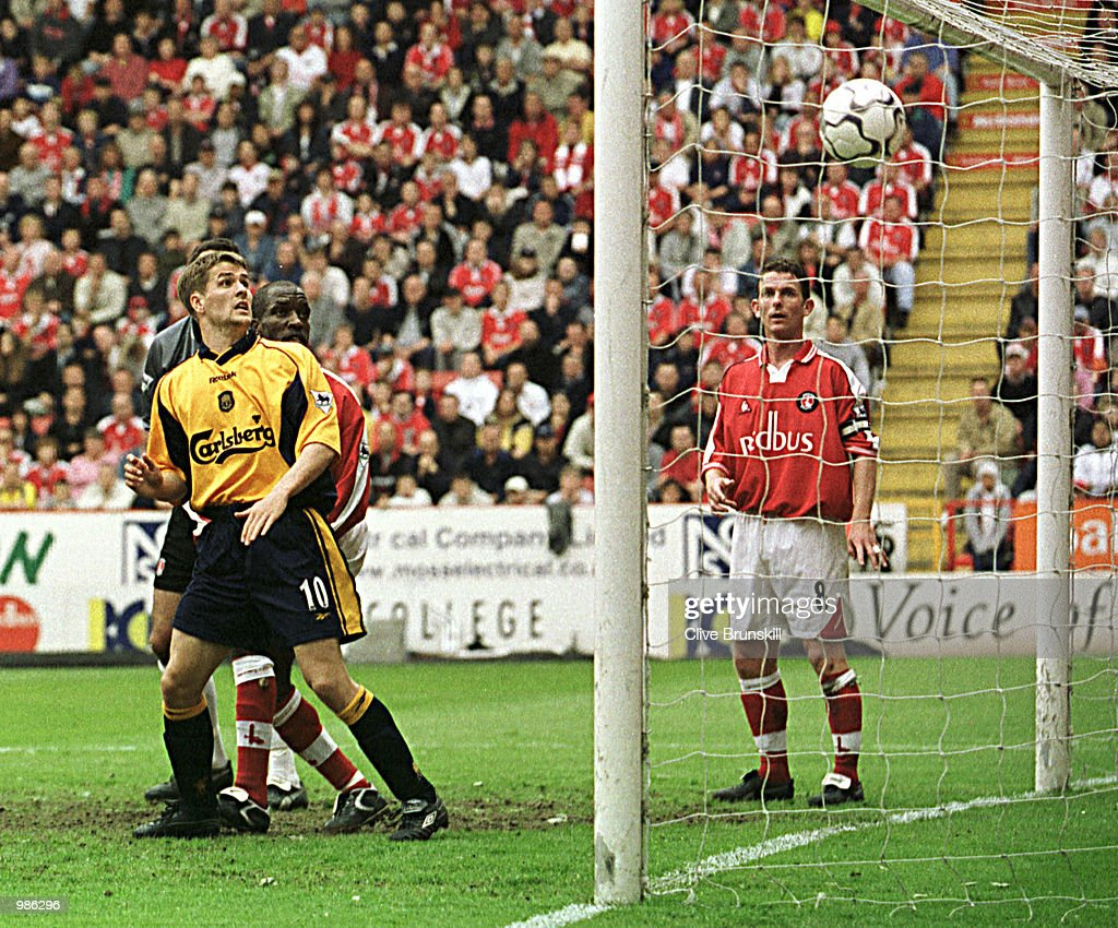 Michael Owen of Liverpool watches the strike of his team mate Robbie Fowler as he scores during the FA Carling Premiership match between Charlton Athletic v Liverpool at The Valley, London. Mandatory Credit: Clive Brunskill/ALLSPORT