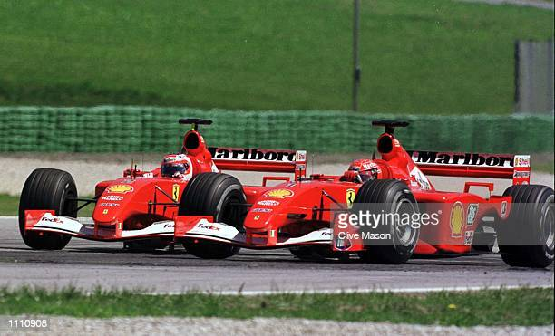 Michael Schumacher of Germany and team mate Rubens Barrichello of Brazil and Ferrari battle it out during the Austrian Grand Prix at the A1 Ring in...