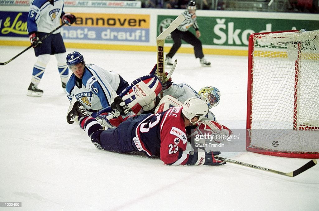 Mike Knuble of USA squeezes the puck over the line during the IIHF World Ice Hockey Championships match against Finland played at the Preussag Arena in Hannover, Germany. \ Mandatory Credit: Stuart Franklin /Allsport