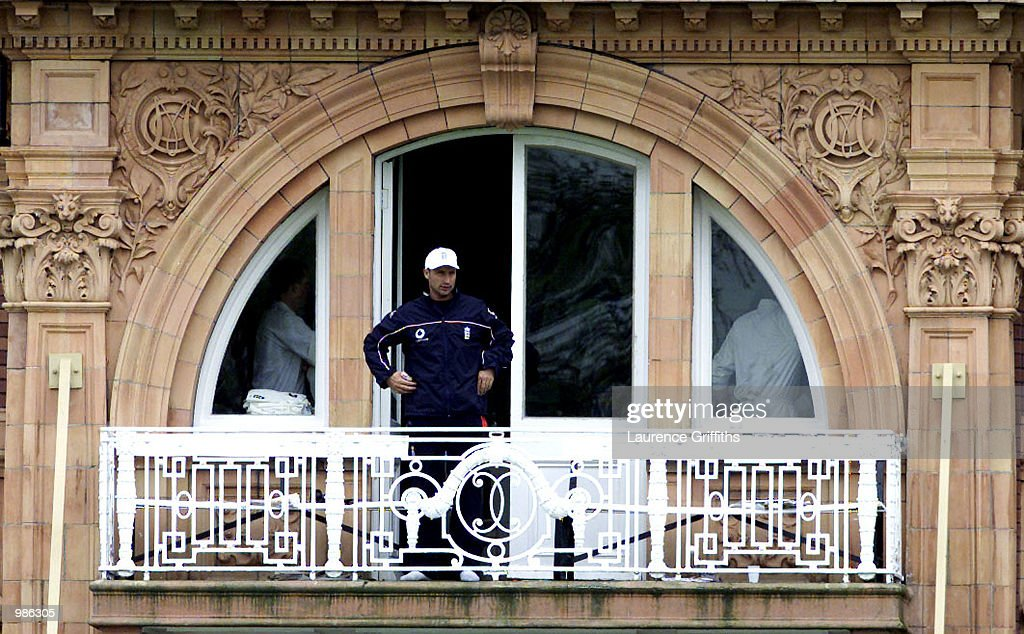 Nasser Hussain of England stands alone as a spectator as he rests his injured finger during the 3rd days play of the npower 1st Test Match at Lords Cricket Ground in London. Digital Image. Mandatory Credit: Laurence Griffiths/ALLSPORT