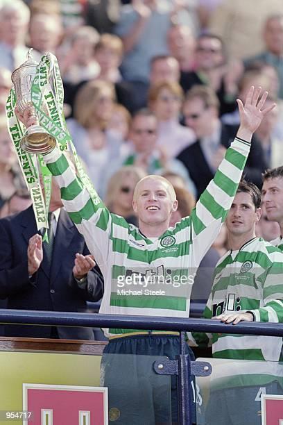 Neil Lennon of Celtic holds the trophy aloft after the Tennents Scottish cup final win against Hibernian at Hampden Park Glasgow Scotland Celtic won...