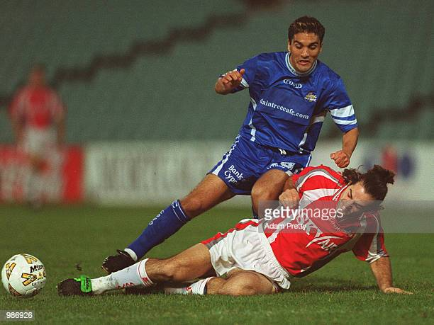 Pablo Cardozo of Sydney Olympic contests the ball with Sasa Ognenovski of Melbourne Knights during the minor semi final at Parramatta Stadium Sydney...
