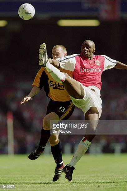 Patrick Vieira of Arsenal stretches to beat Danny Murphy of Liverpool during the AXA Sponsored FA Cup Final at the Millennium Stadium in Cardiff,...