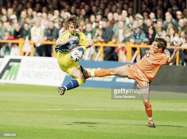 Paul Holmes of Torquay United wins the challenge against Darren Currie of Barnet during the Nationwide League Division Three match played at...