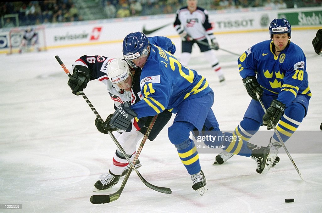 Phil Housley of USA (left) is checked by Sweden's Jorgen Jonsson as team mate Andreas Johansson (right) comes in to steal during the IIHF World Ice Hockey Championship Third place play-off match between Sweden and the USA played at the Preussag Arena in Hannover, Germany. \ Mandatory Credit: Stuart Franklin /Allsport