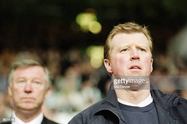 Portrait of Manchester United Assistant Manager Steve McClaren with Manager Sir Alex Ferguson watch the action during the Tom Boyd Testimonial match...