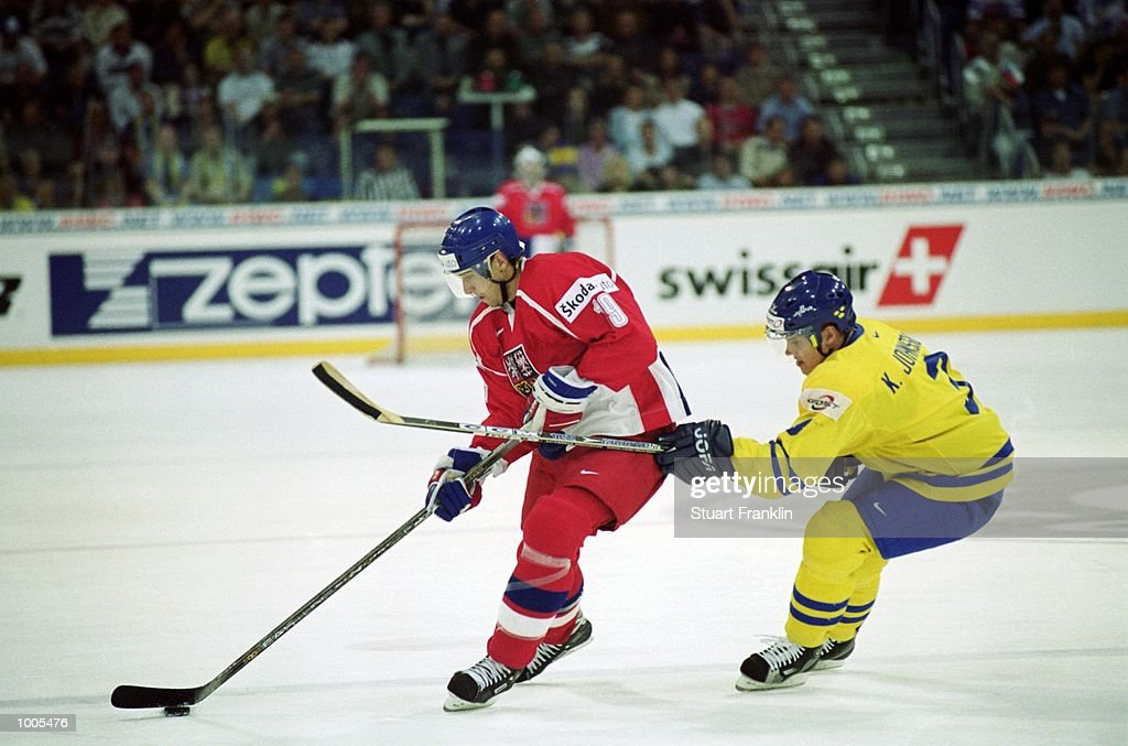 Radek Dvorak of Czechoslavakia shields the puck from Kim Johnsson of Sweden during the IIHF World Ice Hockey Championships match between Sweden and Czechoslavakia played at the Preussag Arena in Hannover, Germany. \ Mandatory Credit: StuartFranklin /Allsport