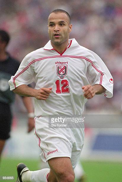 Raouf Bouzegne of Tunisia in action during the World Cup 2002 Group D Qualifying match against Ivory Coast played at the El Menzah Stadium in Tunis...