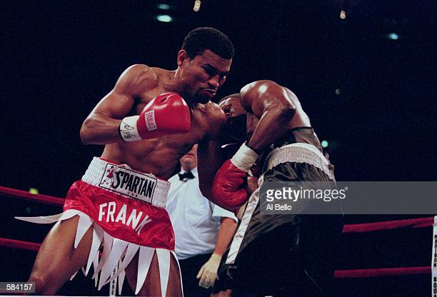 Raul Frank lands a punch in Vernan Forrest's belly during the fight at Madison Square Garden in New York New York Frank defeated Forrest in the 12th...