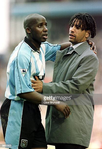 Richard Shaw of Coventry consoles Paul Williams after defeat and relegation after the FA Carling Premier League game between Aston Villa v Coventry...