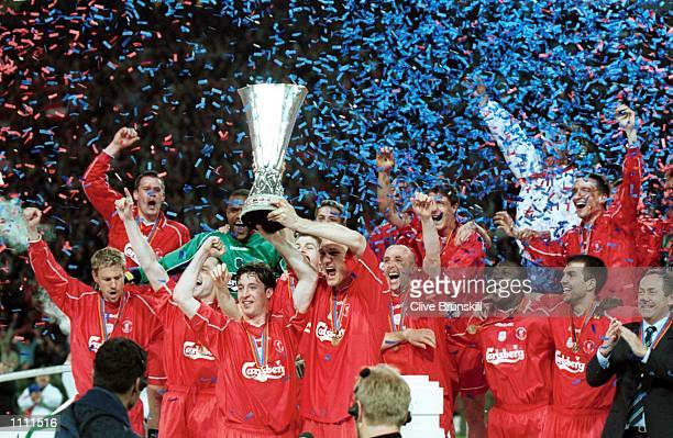 Robbie Fowler lifts the trophy after Liverpool's victory in the UEFA Cup Final between Liverpool and Deportivo Alaves at the Westfallenstadion...