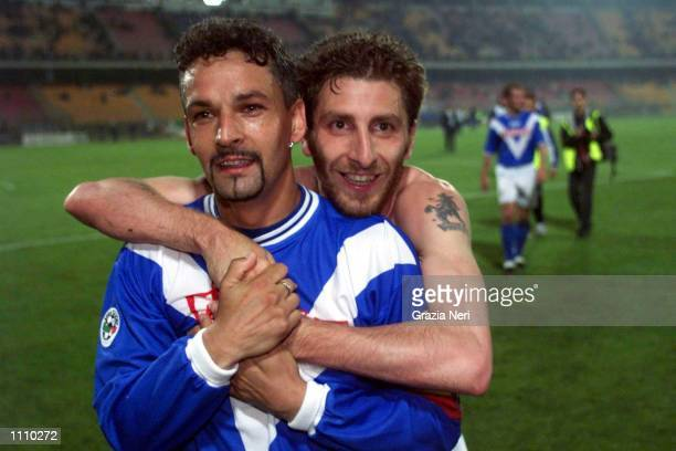 Roberto Baggio and Bachini of Brescia celebrate during the Serie A 29th Round League match between Lecce and Brescia played at the Via del Mare...