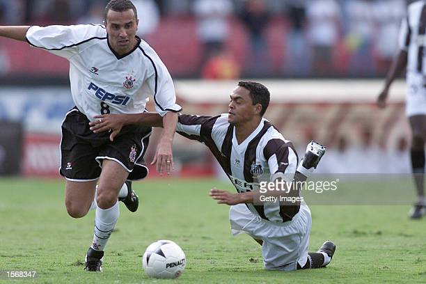 Rogerio of Corinthians and Dodo of Santos in action during the Corinthians and Santos Sao Paulo Championship semifinal match played at the Morumbi...